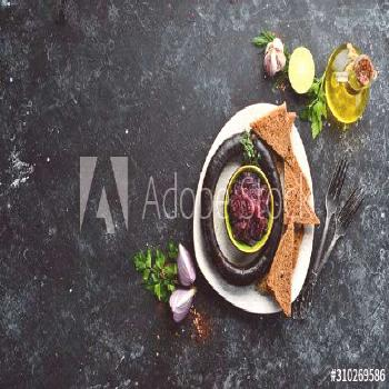 Buckwheat blood sausage and caramelized sweet onions with black bread. Trout. Top view. free space