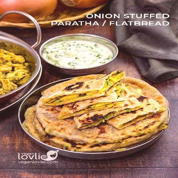 Delicious soft stuffed paratha or roti flatbread filled with lightly spiced caramelized Spanish Swe