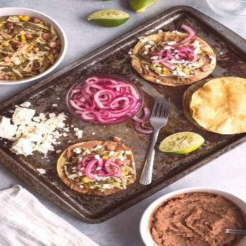 Nopales Slaw Tostadas with Pickled Red Onions -  Nopales Slaw Tostadas made with hominy and Mexican