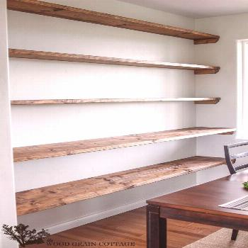 Over year ago I wrote a post about how I wanted to add a big wall of shelving to our dining room. A
