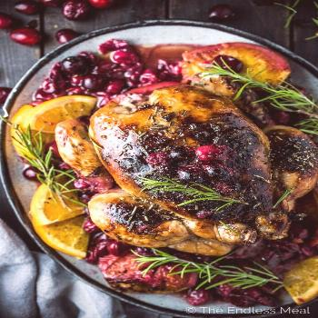 SAVE FOR LATER! This crazy delicious Orange Cranberry Roast Chicken is covered with rosemary balsam
