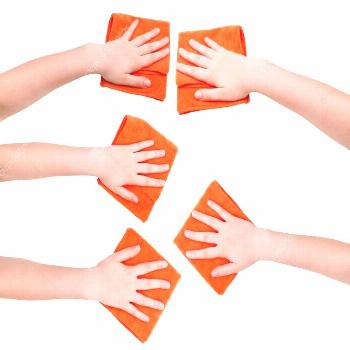 Set of hands with orange microfibre rags isolated - Stock Photo ,