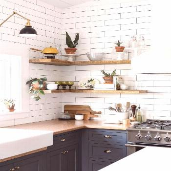 styled open shelving in the kitchen of this Vintage Eclectic Barn