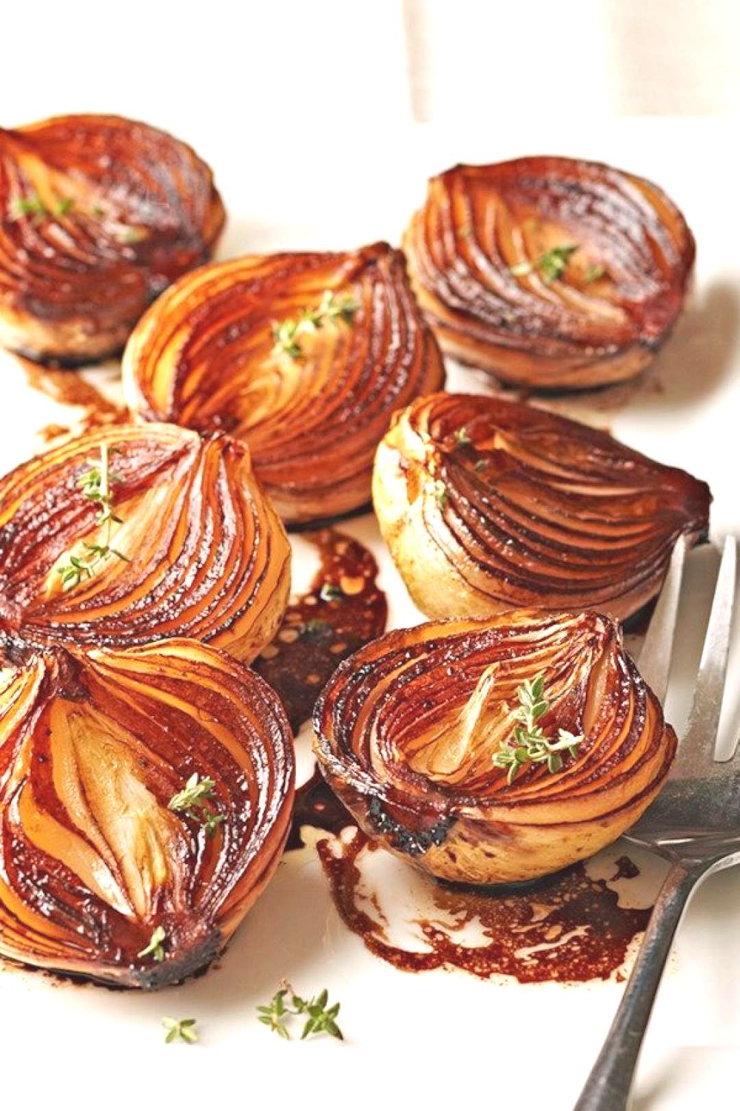 Caramelized Balsamic Onions - As these onion halves cook, the balsamic mixture becomes syrupy and
