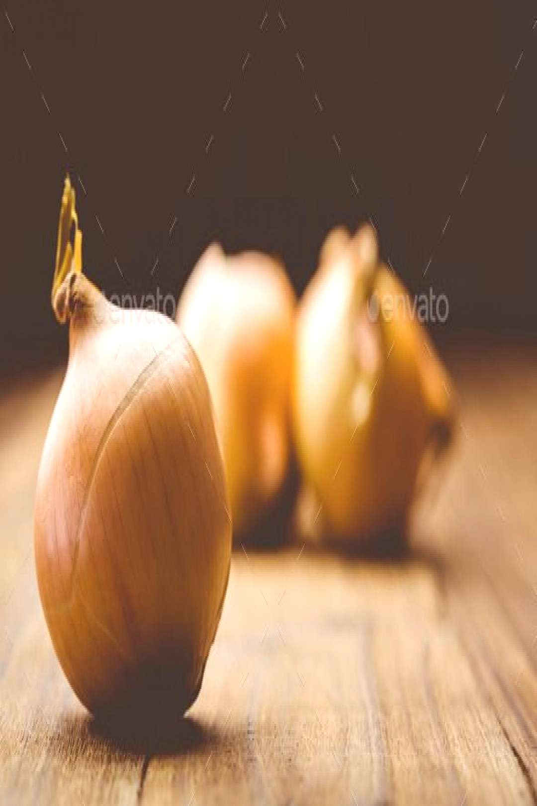 Fresh onions on wooden background by Wavebreakmedia. Fresh onions on wooden background