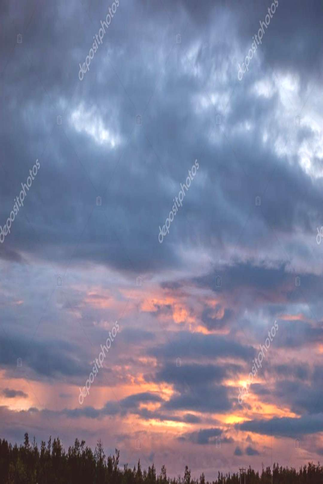Gray, blue and orange clouds at sunset - Stock Photo ,
