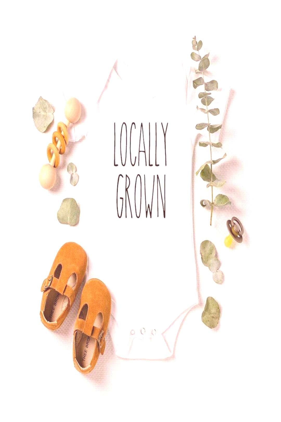possible text that says LOCALLY GROWNYou can find Onesies and more on our website.possible text t